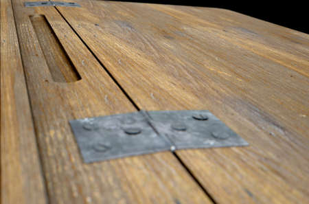 ink well: A 3D rendering of a closeup of a vintage wooden school desk