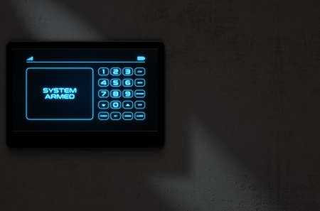 A 3D render of a modern touch screen interactive home security keypad access panel with an illuminated digital numeric keypad and words that read system armed