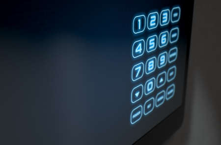 teclado numérico: A 3D render of a modern touch screen interactive home security keypad access panel with an illuminated digital numeric keypad Foto de archivo