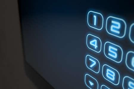 teclado numérico: Una representación 3D de una casa de seguridad del panel de acceso interactivo teclado de la pantalla táctil moderna con un teclado numérico digital, sistema de iluminación Foto de archivo