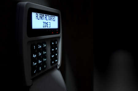 break in: A 3D render of a home security keypad access panel with buttons and an illuminated screen displaying a break in or security breach