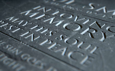 A 3D render of closeup of a carved and etched tombstone highlighting the word in loving memory Stock Photo