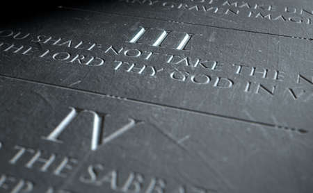 highlighting: A 3D render of closeup of the ten commandments etched in a stone tablet highlighting the third Stock Photo