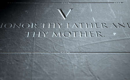 fifth: A 3D render of closeup of the ten commandments etched in a stone tablet highlighting the fifth Stock Photo