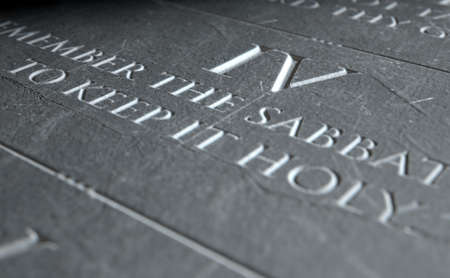 etched: A 3D render of closeup of the ten commandments etched in a stone tablet highlighting the fourth Stock Photo