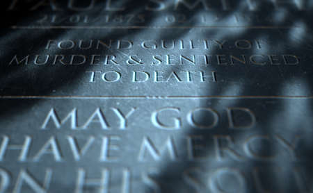 murdering: A 3D render of closeup of a carved and etched tombstone of a convicted murderer