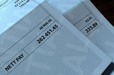 disparity: A 3D render concept showing two fictitious paychecks with a huge difference in the nett pay highlighting the income inequality created by capitalism