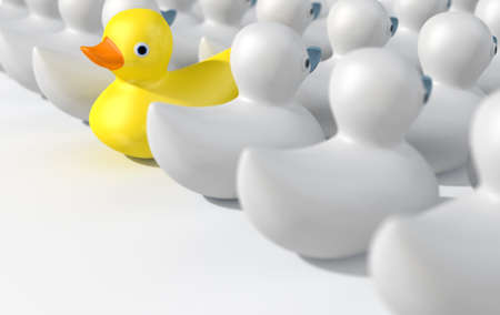 against the flow: A non-conformist depiction of a yellow rubber bath duck swimming against the flow of white rubber ducks on an isolated white studio background. 3D render