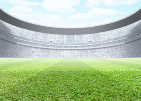 A generic seated stadium with a green grass pitch in the day time under a blue cloudy sky - 3D render Stock Photo