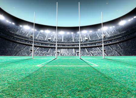 A generic seated aussie rules stadium showing goal posts on a green grass pitch at night under illuminated floodlights - 3D render Stockfoto