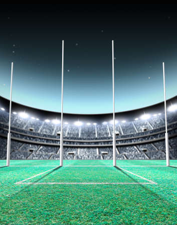 A generic seated aussie rules stadium showing goal posts on a green grass pitch at night under illuminated floodlights - 3D render Standard-Bild
