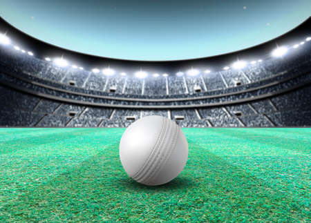 A generic seated cricket stadium with a white ball on a green grass pitch at night under illuminated floodlights - 3D render