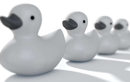 organise: A row of organised and ready grey rubber bath duck toys on an isolated background - 3D render
