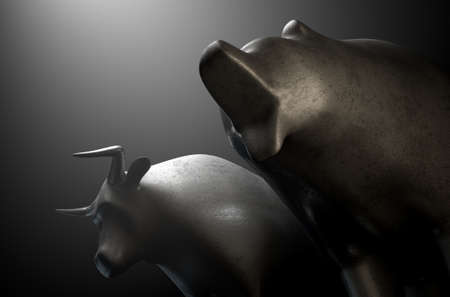 castings: A closeup of two metal castings depicting a stylized bull alongside a bear in dramatic light representing  financial market trends on an isolated dark background - 3D render Stock Photo