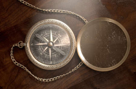 copper magnet: A closeup of an intricate vintage pocket compass with an open lid and a chain attached - 3D render Stock Photo