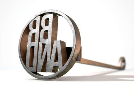 proprietary: A metal cattle branding iron with the word brand as the marking area on an isolated white surface - 3D render