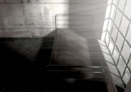 run down: A metaphor showing a literal bed of nails in a dimly lit run down room with a dramatic morning light penetrating through the window - 3D Render