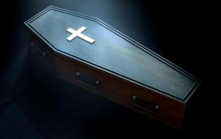 薄暗いスポット ライト - 3 D のレンダリングによって金属十字架とハンドルの付いた木製の棺が薄暗い