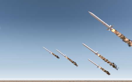 A row of intercontinental ballistic missiles launching in a desert on a blue sky backgrund - 3D render Standard-Bild