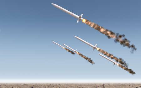 Una fila de misiles balísticos intercontinentales que se lanzan en un desierto en un cielo azul backgrund - 3D render