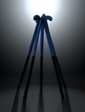 backlit: A circular array of blue and black field hockey sticks on a dark dramatic backlit background - 3D render Stock Photo