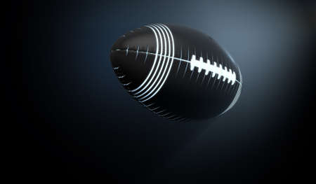 pioneering: A futuristic sports concept of a black textured american football ball lit with neon markings flying through dark space - 3D render Stock Photo