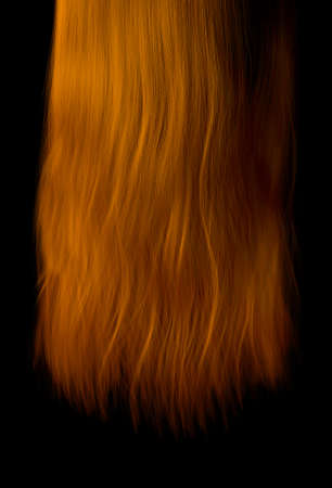 A length of hanging shiny wavey ginger hair on an isolated dark background - 3D render Stock Photo