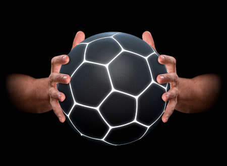 3d ball: A pair of male hands clamping a futuristic soccer ball on an isolated dark background - 3D render Stock Photo