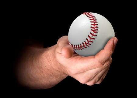 3d ball: A male hand holding a baseball on an isolated dark background - 3D render Stock Photo