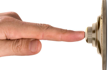 A male finger pressing a vintage brass doorbell on an isolated background - 3D render