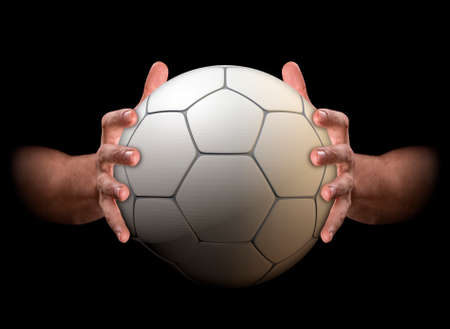 A pair of male hands clamping a soccer ball on an isolated dark background - 3D render