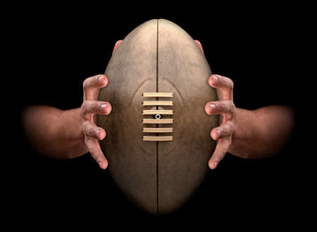 3d ball: A pair of male hands clamping a vintage rugby ball on an isolated dark background - 3D render