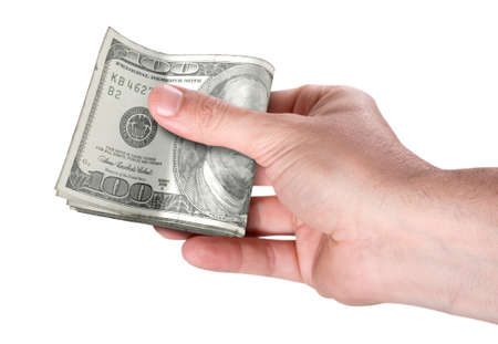 A male hand handing over a wad of folded american dollar bank notes on an isolated background