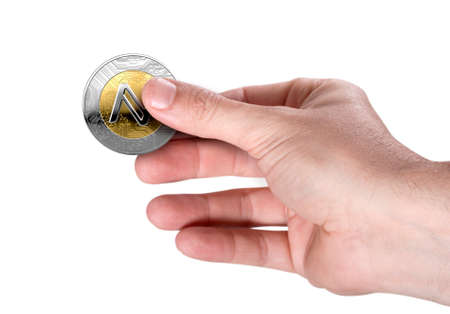 A male hand holding a physical namecoin cryptocurrency in gold and silver coin form on a dark studio background