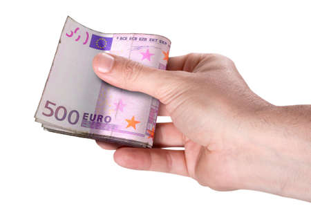 A male hand handing over a wad of folded euro bank notes on an isolated background