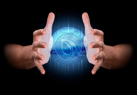 enveloping: A pair of male hands enveloping a hologram of a peercoin on an isolated dark background Stock Photo