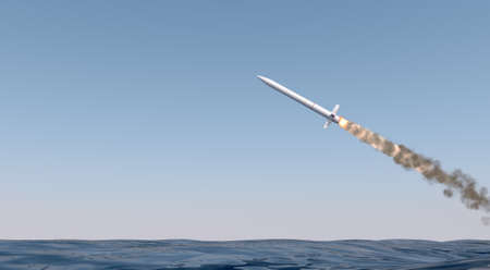 An intercontinental ballistic missile launching across the ocean on a blue sky backgrund - 3D render