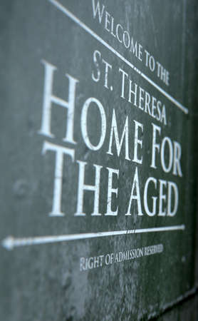 A dilapidated closeup of a sign for the premises of a fictional old age home - 3D render