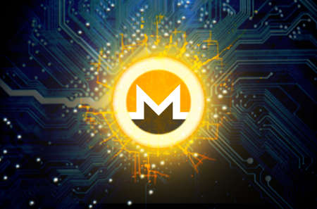 A monero cryptocurrency hologram coin form hovvering over a computer circuit board Stock Photo