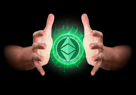 A pair of male hands reaching through the dark grasping at an ethereum hologram