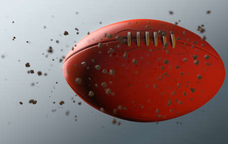 A dirty orange aussie rules ball caught in slow motion flying through the air scattering dirt particles in its wake - 3D render Stock Photo