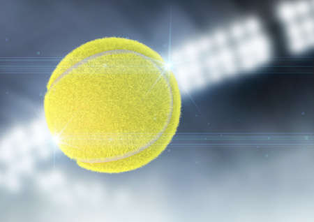 A tennis ball caught in slow motion flying through the air on a night stadium background - 3D render Stock Photo
