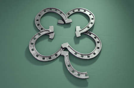 Four green metal horseshoes formed into the shape of a shamrock on an isolated green background -3D render Stock Photo