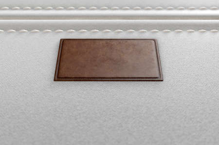 A close up view of a section of white canvas fabric with a blank tan leather label stitched onto it - 3D render 版權商用圖片