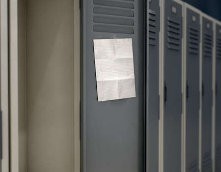 A row of metal school lockers with one open door and a blank page note taped to the inside - 3D render