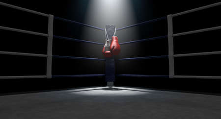 The blue corner of a boxing ring with gloves hanging on a pole spotlit on an isolated dark background - 3D render Foto de archivo