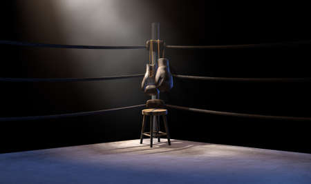 A closeup of the corner of an old vintage boxing ring surrounded by ropes spotlit by a spotlight on an isolated dark background - 3D render