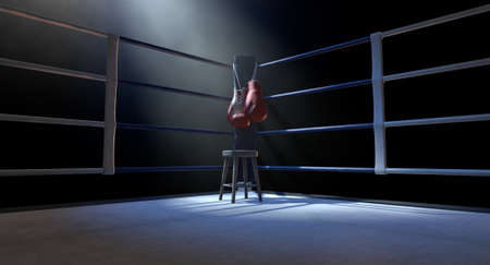 The blue corner of a boxing ring with gloves hanging on a pole spotlit on an isolated dark background - 3D render Archivio Fotografico