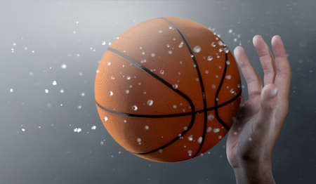 A closeup of a basket ball caught in slow motion flying through the air about to be caught by a dirty hand  - 3D render