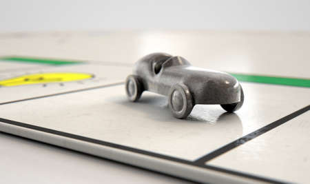 A closeup of a metal die cast car icon on a game board  - 3D render Stock Photo